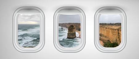 Twelve Apostles coastline as seen through three aircraft windows. Holiday and travel concept. Stock Photo