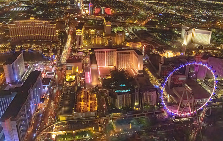 Night aerial view of Las Vegas skyline from helicopter.
