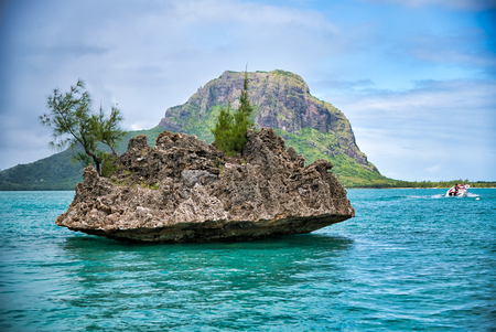 Crystal Rock in the turquoise waters of the Indian Ocean at Le Morne, Mauritius - Africa.