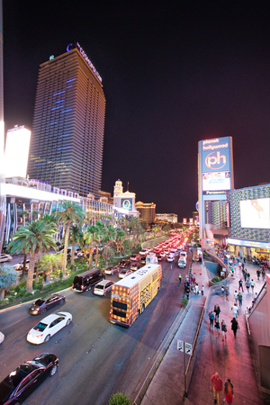 LAS VEGAS, NV - JUNE 29, 2018: Car night traffic along The Strip Avenue. Las Vegas is known as the Sin City, City of Lights, Gambling Capital of the World.