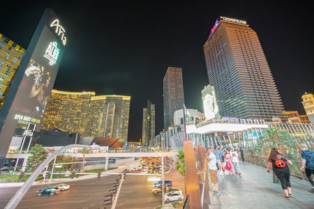 LAS VEGAS, NV - JUNE 29, 2018: Tourists walk along The Strip Avenue at night. Las Vegas is known as the Sin City, City of Lights, Gambling Capital of the World. Editorial
