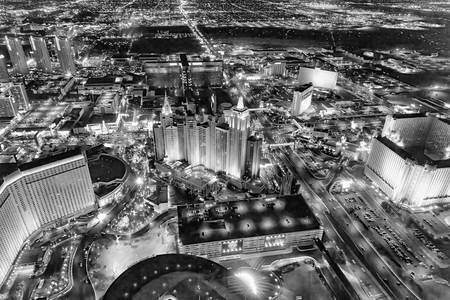 LAS VEGAS, NV - JUNE 29, 2018: Aerial night view of city streets. Las Vegas is known as the Sin City, City of Lights, Gambling Capital of the World.