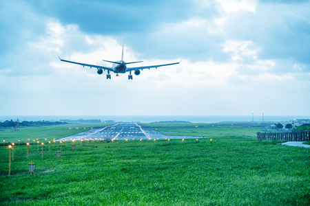 Giant aircraft landing at the airport with runway in the background. Back view. Stock fotó