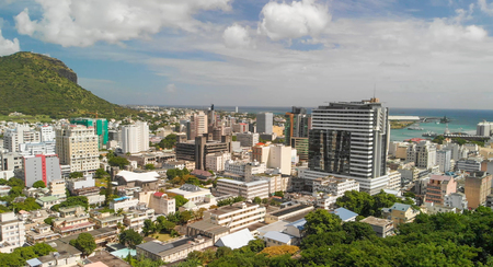 Panoramic sunset view of Port Louis skyline from city fortress, Mauritius.