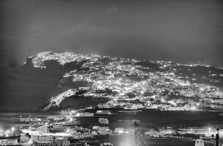 Aerial view of Santorini island coast at night.