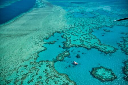 Natural Great Barrier Reef in Queensland. Aerial view of nature paradise with magnificent colors. Stock Photo
