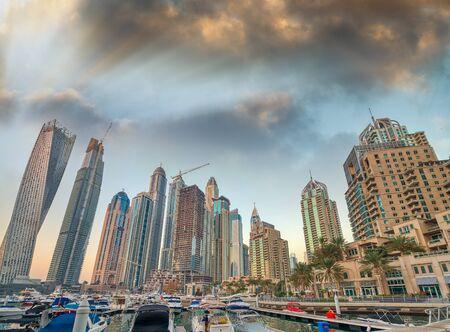 Beautiful sunset skyline of Dubai Marina, United Arab Emirates.