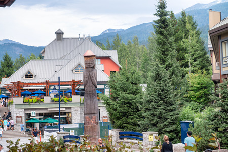 WHISTLER, CANADA - AUGUST 12, 2017: Tourists enjoy city center on a summer day. Whistler is a famous mountain destination in British Columbia.