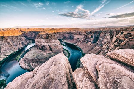 Dawn at Horseshoe Bend. Sunrise colors with Rocks and Colorado River. 写真素材