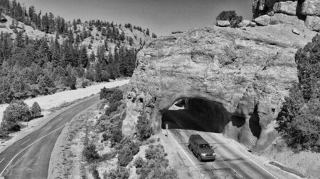Tunnel entrance of Red Canyon and Bryce Canyon. Red arch located at the entrance of national park.