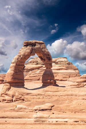 Delicate Arch as seen from lower point of view at sunset, Arches National Park, UT. Imagens