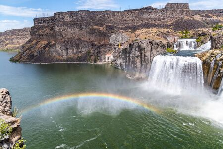 Powerful Shoshone Falls on a cloudy daywith rainbow, Idaho. Фото со стока