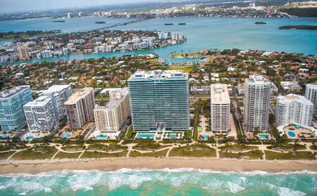 Aerial view of Collins Avenue and Buildings, Eastern Shores, Miami. Фото со стока