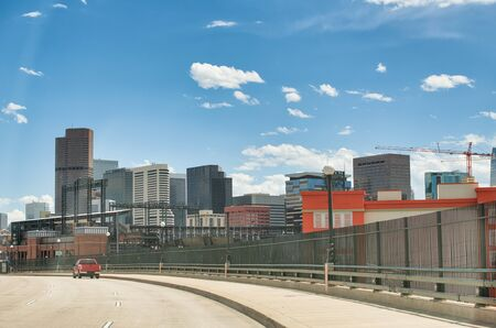 Denver skyline as seen from main road, Colorado. Arriving in the city. Stock Photo