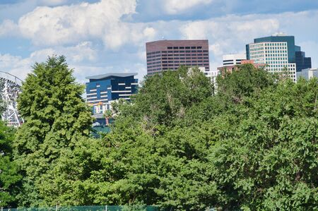 Skyline of Denver surrounded by trees on a beautiful summer day, Colorado