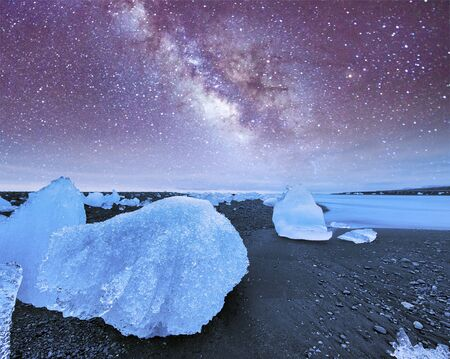 Icebergs at night in Jokulsarlon Lagoon, Iceland. Фото со стока