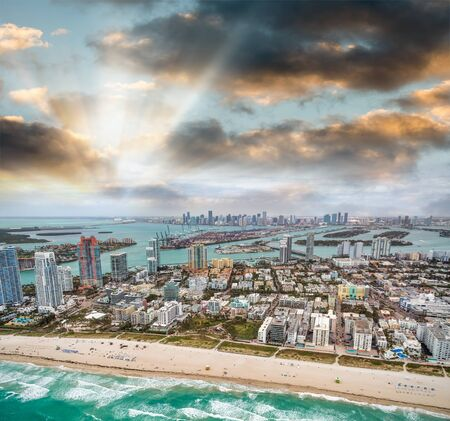 Panoramic aerial view of Miami Beach and Downtown Miami with ocean, buildings and causeways, Florida