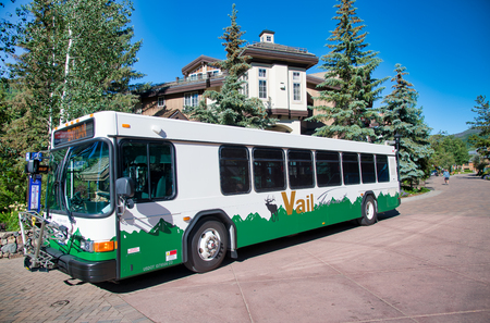 VAIL, CO - JULY 3, 2019:  City bus along the main street on a wonderful sunny day. Vail is a famous tourist attraction.
