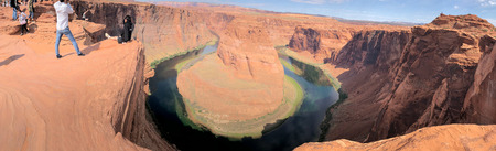 HORSESHOE BEND, USA - JUNE 29, 2019: Panoramic view of Horseshoe Bend and Colorado River with tourists, USA. Editöryel