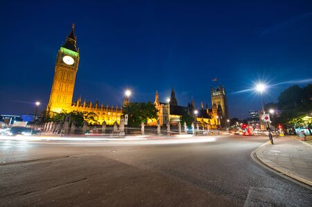 Night traffic n Westminster, London. The Big Ben and Houese of Parliament.