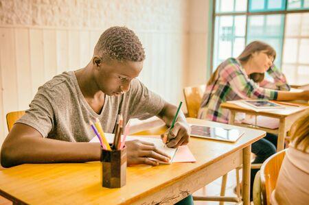 African boy in the classroom doing school test. Zdjęcie Seryjne