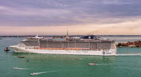 VENICE, ITALY - APRIL 2014: Cruise ship in Grand Canal. Crise ships are very dangerous in such a small space. Editorial