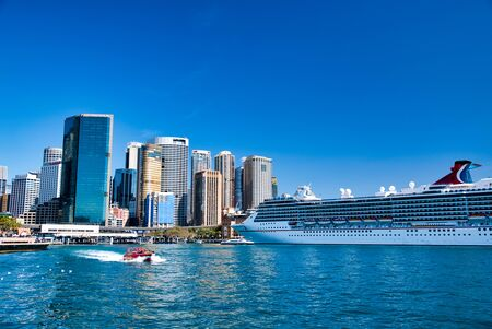 SYDNEY - AUGUST 20, 2018: Cruise ship docked in Sydney Harbor. Sydney attracts 20 million tourists annually.