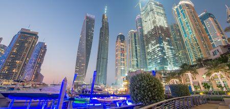 DUBAI, UAE - DECEMBER 10, 2016: Aerial view of Dubai Marina skyline. Dubai attracts 15 million people every year.