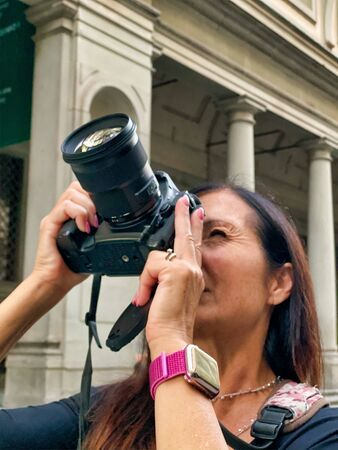 Female photographer in Florence, Italy.