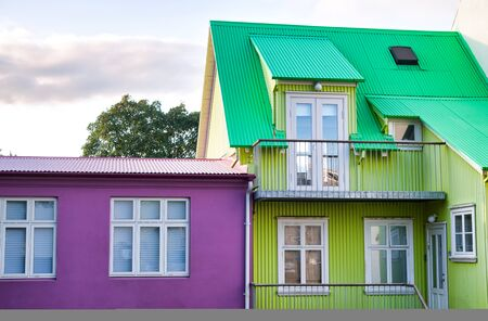 Beautiful colors of Reykjavik homes. Purple and green colors. Stockfoto - 131857987