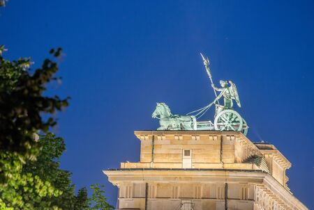 Brandenburg Gate at night in Berlin. Stock Photo
