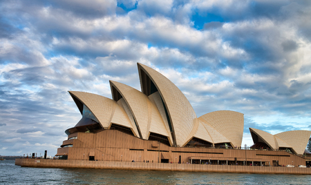 SYDNEY - NOVEMBER 6, 2015: Beautiful view of Sydney Opera House  on a cloudy day. Sydney attracts 20 million tourists every year.