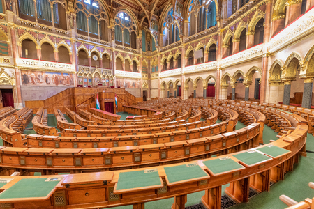 BUDAPEST, HUNGARY - MARCH 31, 2019: Interior of Budapest Parliament Building and government assembly room. Editorial