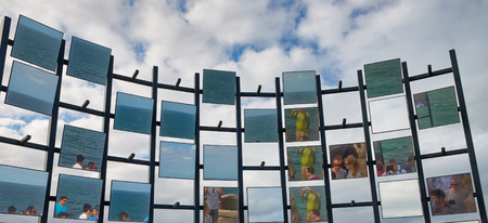 SYDNEY - NOVEMBER 6, 2015: Beautiful view of Bondi Beach promenade with art collection exposition on a cloudy day. Sydney attracts 20 million tourists every year. 報道画像