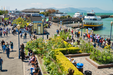 SAN FRANCISCO, CA - AUGUST 7, 2017: Aerial view of tourists in Fishermans Wharf. The city attracts 20 million tourists annually.