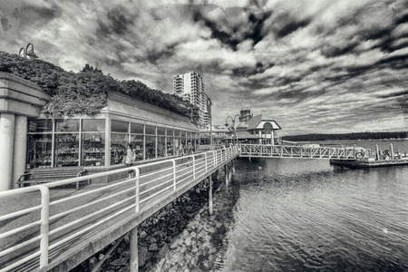 NANAIMO, CANADA - AUGUST 14TH, 2017: City promenade along the sea. This is a major city in Vancouver Island.