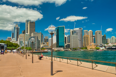 SYDNEY - OCTOBER 2015: City skyline on a sunny day. The city attracts 20 million people annually.