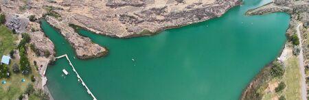 Panoramic aerial view of beautiful green lake in a mountain scenario. Stock fotó