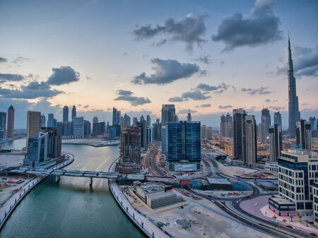 Downtown Dubai at sunset, UAE. Amazing aerial view from drone.