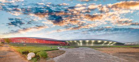 Panoramic view of Abu Dhabi Sports Racing Stadium at sunset, UAE.