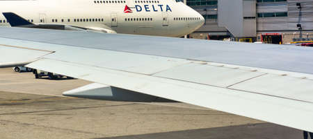 NEW YORK CITY - JUNE 8, 2013: Delta Airlines Aircrafts in JFK international airport. Delta is a major US company Editorial