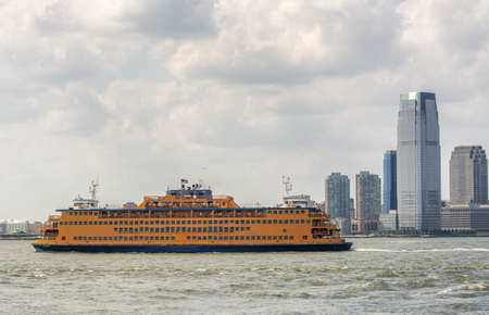 Ferry in front of Jersey City, New York City. Holiday and travel concept.