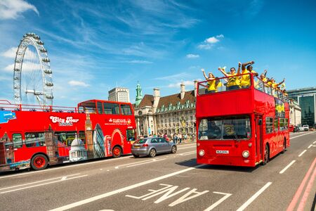 LONDON - JULY 3, 2015: Red Double Decker Bus speeds up along city streets.