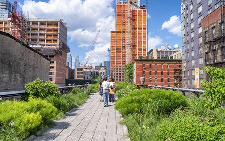 NEW YORK CITY - JUNE 2013: Tourists and locals enjoy High Line Park in summer season, Manhattan.