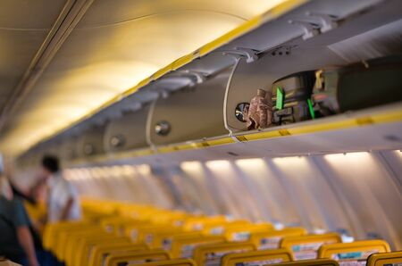 Illuminated interior of airplane, holiday and travel concept, shallow DoF.