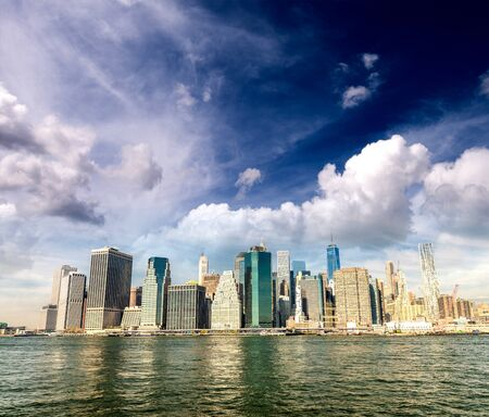 Lower Manhattan buildings and East River reflections on a sunny day, New York City, USA Stock Photo