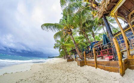 Beautiful beach of Honduras on a cloudy day. Stock Photo