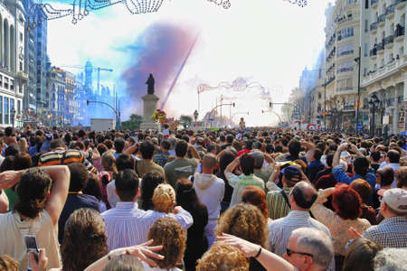 VALENCIA, SPAIN - MARCH 3, 2007: Tourists and locals in the Town Hall Square for Valencia`s Fallas festival.