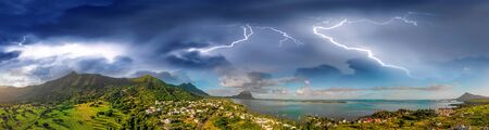 Amazing aerial panoramic view of Mauritius Island with tropical storm approaching, Africa.