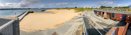 REYKJAVIK, ICELAND - AUGUST 11, 2019: Nautholsvik Geothermal Beach on a sunny summer day. It is a sandy beach with a man made hot spring.